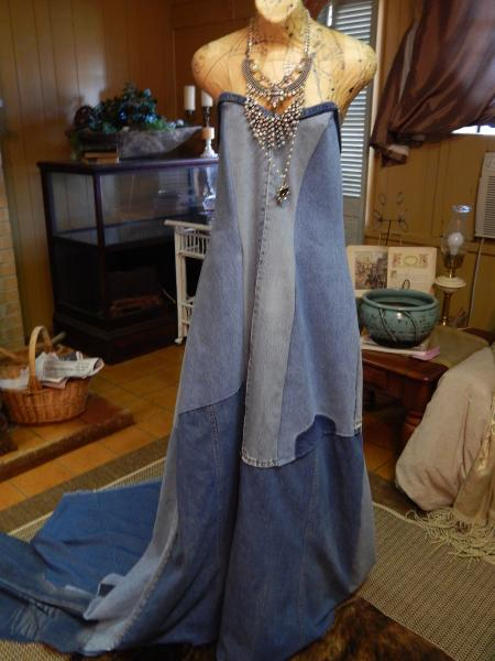 20203 Michael J Bleached Denim Dress has a train and a zipper in the back. It is made from pre-loved jeans. To order specify bust, waist, and hip measurements. A length measurement will also be needed.]
