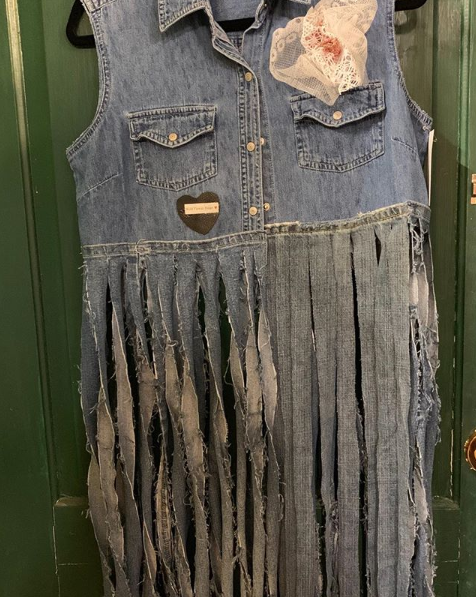 20205 Sally Chambray Fringed Vest $99 is a cropped chambray vest with long denim fringe. It comes in sizes small - large.