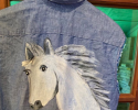 20223 Jamee Handpainted Chambray Vest had a white horse on the back and added red cotton fringe. Sizes come small - large.