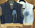 20225 Patsy Cropped Chambray Vest $85 has tea stained crochet trim and a removable fabric flower. It comes in sizes small - plus.
